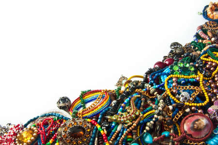 heap of multi-coloured bright jewelry isolated on a white background photo
