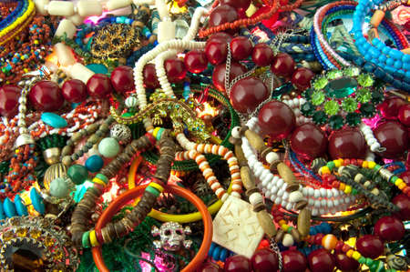 heap of multi-coloured bright jewelry background photo