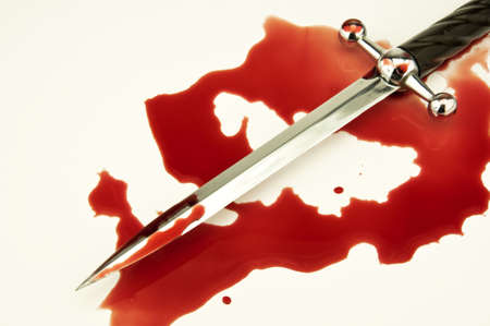 criminal scene with a dagger and patches of fresh blood Stock Photo