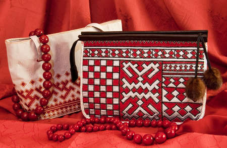 bead embroidery: handbags with ornament in northern style on a red background