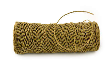hank: Hank of brown paper rope isolated on white background.