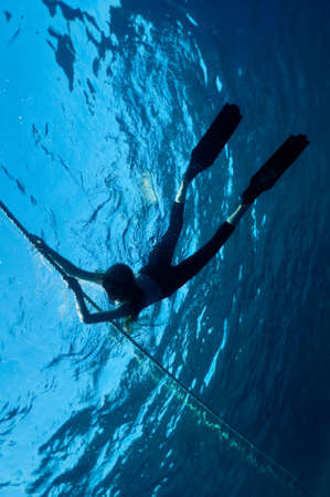 freediver girl in the depths of the turquoise sea