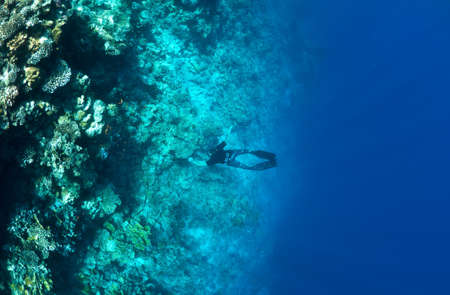 Underwater life. Man snorkeling at a coral reef photo