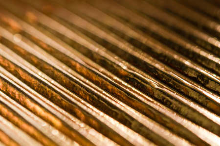 corrugated gold abstract background. closeup. photo
