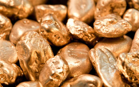 shiny gold nuggets background. closeup. Stock Photo