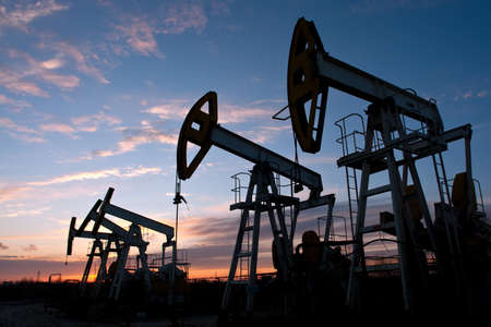 oil pumps at sunset sky  background  Stock Photo