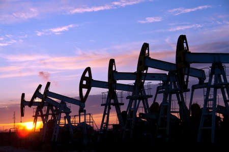 oil pumps on the sunset sky background