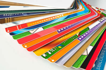stack plastic credit cards and giftcards, closeup