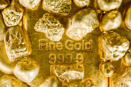 fine gold ingots and nuggets.  photo