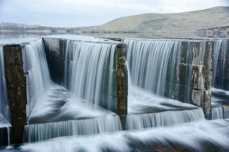 hydroelectric: Water flowing from dam. lake.