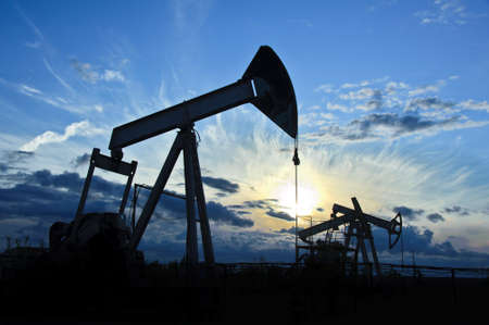 oil: oil pumps on the sunset sky background