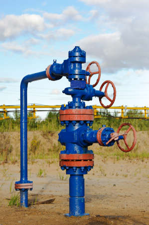 armature: Oil, gas industry. Wellhead with valve armature. Stock Photo