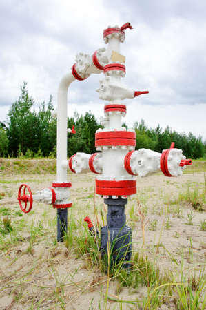 junction pipe: Oil, gas industry. Wellhead with valve armature. Editorial