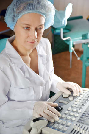 Female doctor in a white uniform working with scientific equipment. photo