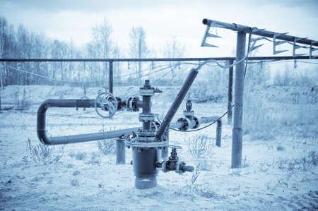 wellhead: Oil, gas industry. Wellhead with valve armature. Toned.