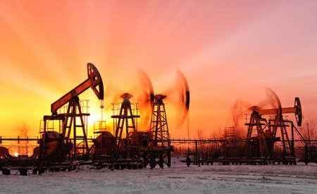 pumpjack: oil pumps at sunset sky background