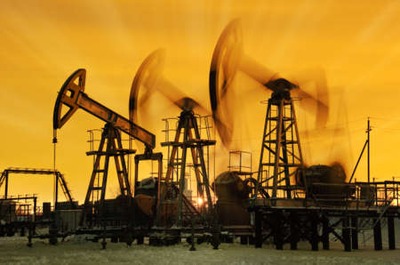 oilfield: Pump jacks  at sunset sky background.