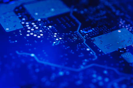 High-tech background. Electronic circuit board. Macro. Selective focus.