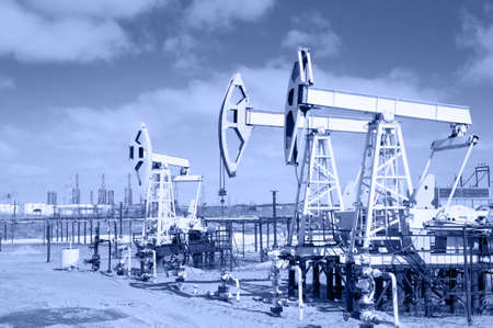 Pump jack group and wellheads  Extraction of oil  Toned
