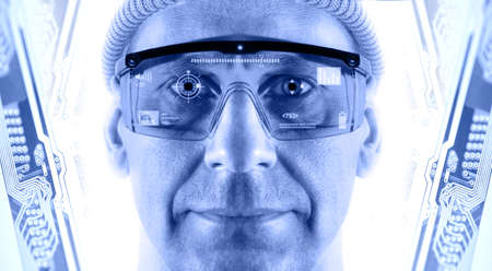 close circuit camera: Portrait of men in smart glasses on a electronic circuit board background  Toned blue