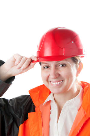 workwear: Caucasian mature woman in a red helmet and workwear, isolated on a white background. Stock Photo