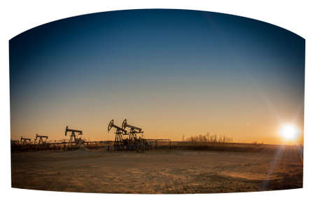 oil and gas: Oil pumps on the sunset sky background.