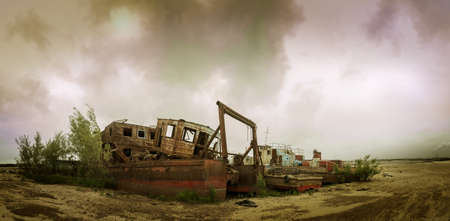 wrecked: Old wrecked boat on the coast. Autumn sky background. Stock Photo