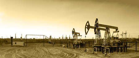oil and gas industry: Oil and gas industry. Panoramic of a pumpjack and oil refinery.