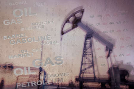 blurred motion: Work of oil pump jack on a oil field and finance analytics background. Textured concrete grunge, blurred motion. Numbers, figures. Concept oil and gas crisis.