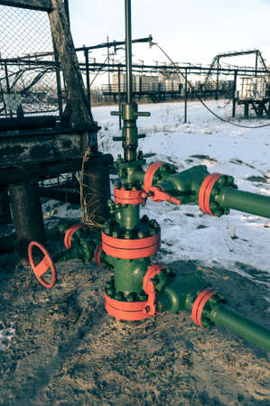 wellhead: Group of wellhead. Oilfield with sand ground. Oil and gas concept