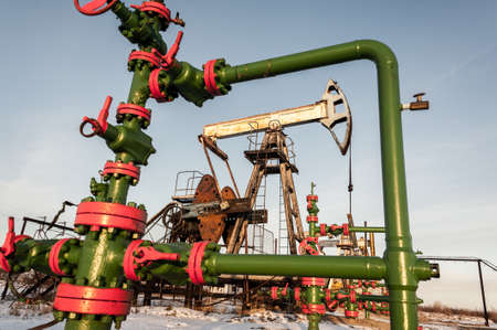 Group of wellhead. Oilfield with sand ground. Oil and gas concept