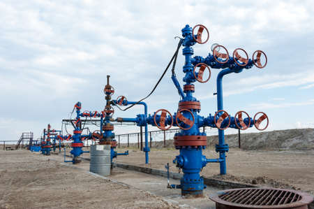 Group production wellheads and conduit with valves. Oil and gas industry.