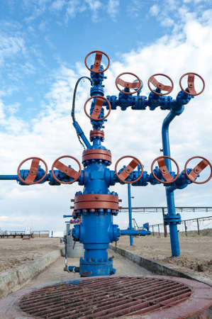 Wellhead with valve armature. Oil, gas industry. Stock Photo
