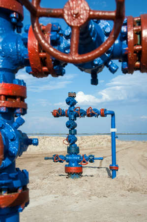 oil industry: Wellhead with valve armature. Oil, gas industry. Stock Photo