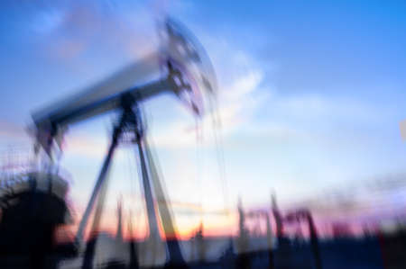 long exposure: Work of oil pump jack on a oil field. Double long exposure, blurred motion.  Concept oil and gas industry.
