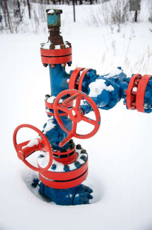 Production wellhead with valve armature. Oil, gas industry. Petroleum theme.
