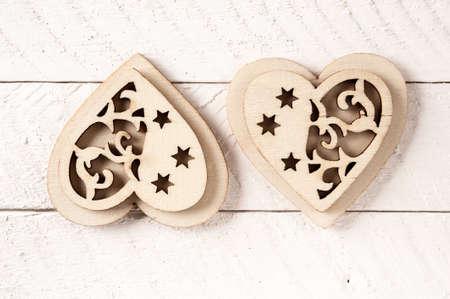 Two wood heart on a vintage wooden background. Standard-Bild