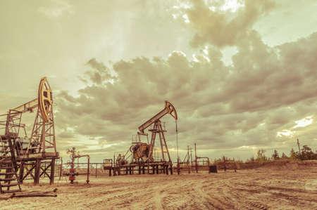 Pump jack. Extraction of oil. Petroleum concept.
