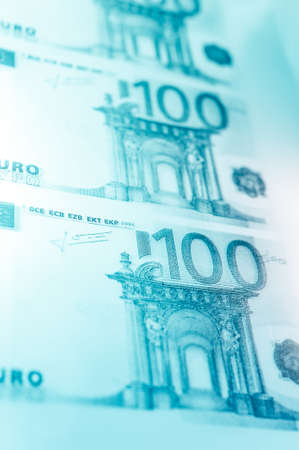 Closeup view of cash money euro bills background. Finance and business theme. Shallow depth of field