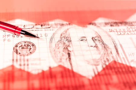 Finance background with money, stock market chart, graph and pen. Living coral toned.