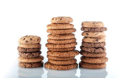 Various shortbread, oat cookies, chocolate chip biscuit isolated on a white background.