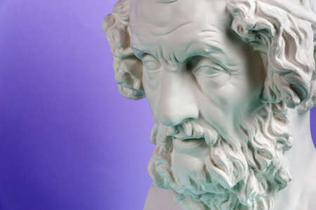Gypsum copy of ancient statue Homer head on a blue background
