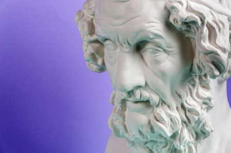 Gypsum copy of ancient statue Homer head on a blue background. Plaster sculpture man face. Archivio Fotografico - 125109108