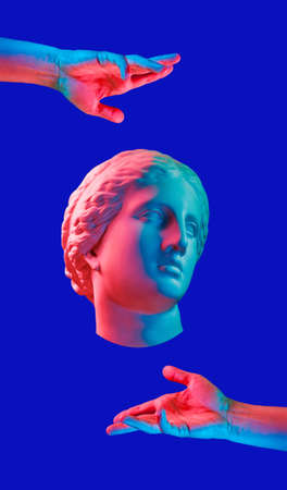Modern conceptual art poster with ancient statue of bust of Venus and hands. Collage of contemporary art.