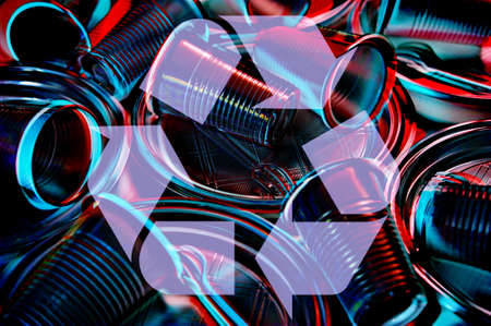 Disposable plastic tableware and recycling sing in a neon lighting colors. Minimalist ecologically clean still life. Pop Art. And ecology problem concept.