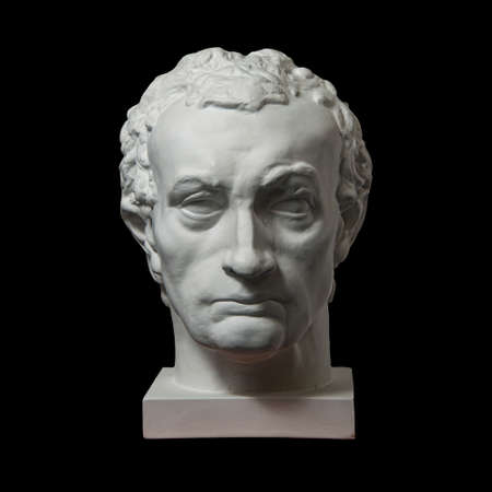 Gypsum copy of ancient statue Gattamelata, Erasmo di Narni, head isolated on black background. Plaster sculpture man face.