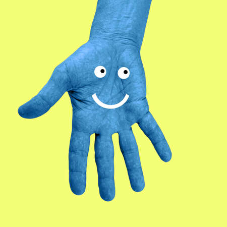 Hand and smiley face in a pop art collage style in neon bold colors. Modern psychedelic creative element with human palm and smile for posters, banners, wallpaper. Magazine style. Zine culture.