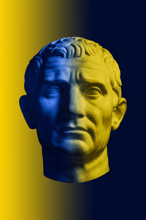 Statue of Guy Julius Caesar Octavian Augustus. Creative concept colorful neon image with ancient roman sculpture Guy Julius Caesar Octavian Augustus head. Cyberpunk, vaporwave and surreal art style. Stock Photo