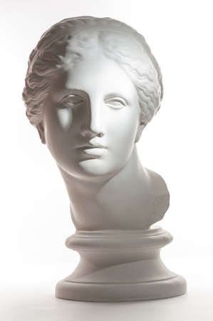 Gypsum copy of ancient statue Venus head isolated on white background. Plaster sculpture woman face. Stock fotó