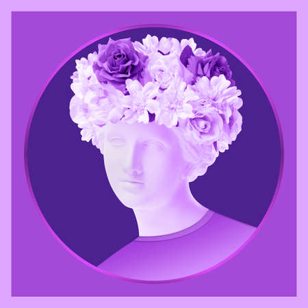 Beautiful young female violet face and colorful flowers. Plaster antique bust of Venus in a floral wreath. Beauty spring and summer model girl with fresh bouquet.